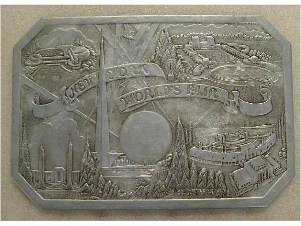 New York World's Fair souvenir hot pad, ca. 1939. Aluminum, cardboard. Gift of Roberta Brandes Gratz, 2008.39.4